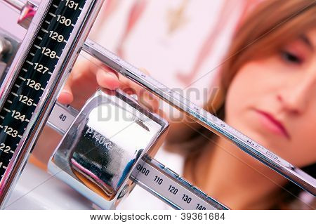 Female Doctor Weighing