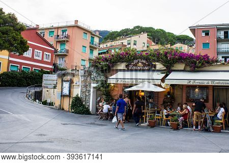 Monterosso Al Mare, Italy - July 8, 2017: People Sitting In A Restaurant In Monterosso Al Mare On A