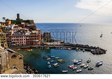 Vernazza, Italy - July 8, 2017: View Of Tourists, Santa Margherita D'antiochia Church, Colorful Boat