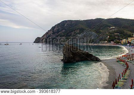 Monterosso Al Mare, Italy - July 8, 2017: View Of Tourists And Fegina Beach In Monterosso Al Mare On