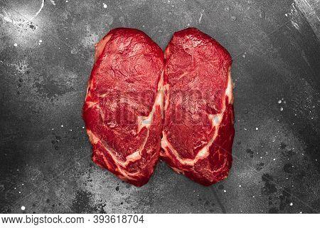 Ribeye Fresh Raw Beef Steak On Dark Background. Top View Flat Lay