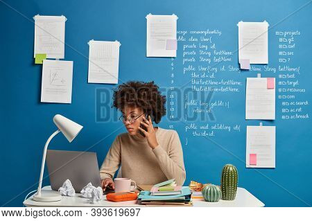 Busy Female Secretary Types Text On Laptop Computer, Sends Feedback, Browses Website, Concentrated I