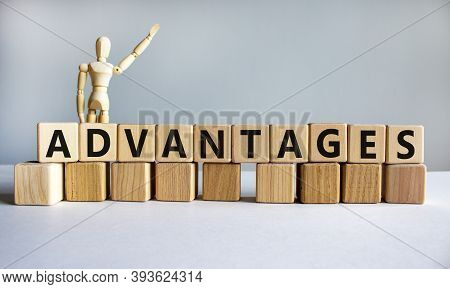 'advantages' Written On Wood Blocks. Business Concept. Wooden Model Of Human. Copy Space. Beautiful