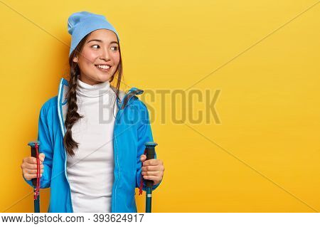 Pretty Smiling Asian Woman Enjoys Scandinavian Walking, Has Hiking Trip, Looks Aside, Leads Active L