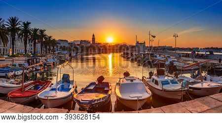 Panoramic View Of Beautiful Split City At Sunrise With Embankment, Palms, Yachts And Sailing Boats A