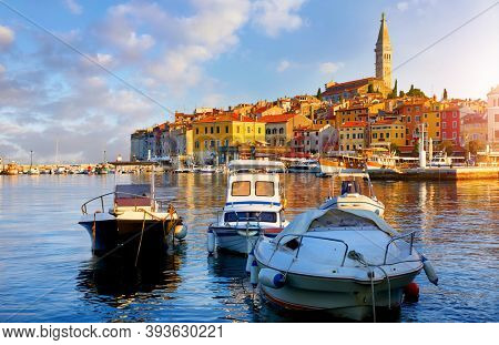 Rovinj, Rovigno, Istria, Croatia. Panoramic view at Romantic old town at Adriatic sea. Boats and yachts in harbor at magical summer sunrise with blue sky. Morning in Europe.