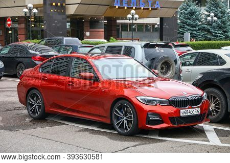 Moscow, Russia - August 13, 2020: Red Compact Sedan Bmw 3-series (g20) In The City Street.