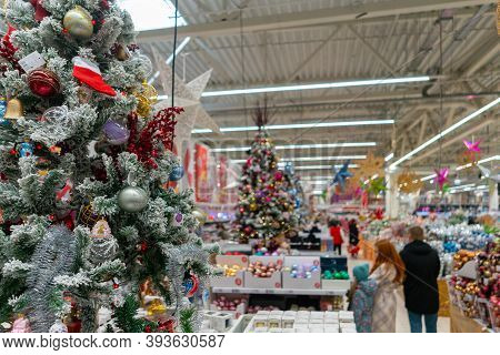 Blurred Christmas Supermarket. Sale Of Festive Christmas Accessories And Trees In A Retail Store. Bl