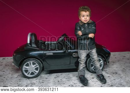 Boy With Modern Look Leaning On Electric Convertible Car Suitable For His Age