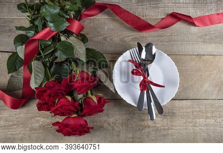 Valentine's Day Concept Valentine's Day. Red Roses With Ribbon On A Wooden Background. Valentine's C