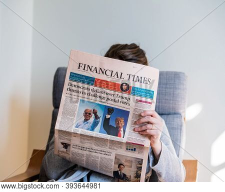 Paris, France - Nov 5, 2020: Square Image Of Woman Reading In Living Room The Latest Ft Financial Ti