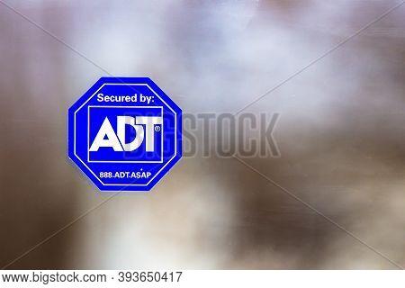 Calgary, Alberta. Canada. Nov. 7, 2020. An Adt Sign Sticker Security Alarm System On A House Window.