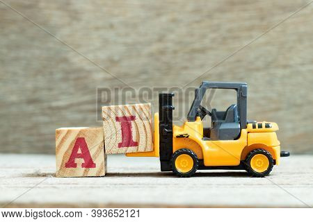 Toy Forklift Hold Letter Block I To Complete Word Ai (abbreviation Of Artificial Intelligence) On Wo