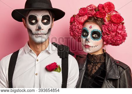 Shocked Couple Have Scary Face Expressions, Funky Makeup And Costumes, Wear Black And White Attire D