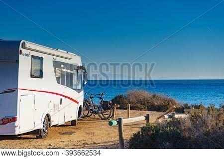 Santa Pola, Spain - March 3, 2019: Camper Vehicle Camping On Mediterranean Coast Of Seaside Spanish