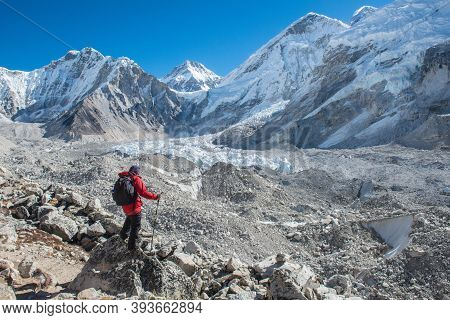 Trekker Standing At The Ridge And Looking To Khumbu Glacier A Large Debris-covered Glacier In The Kh