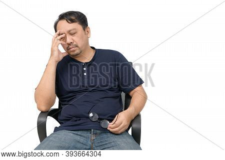 Middle-aged Man Sitting On Chair And Feeling Stressed And Headache Isolated On White Background. Pro