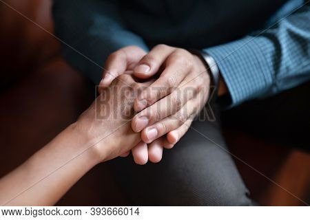 Young Man Husband Holding Hand Of Beloved Wife Asking Forgiveness