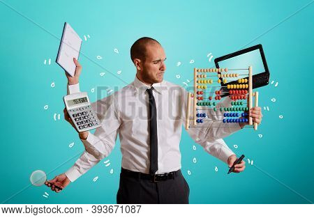Businessman Who Daoes A Lot Of Tasks Simultaneously. Concept Of Owerwork And Multitasking