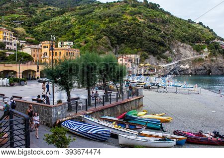 Monterosso Al Mare, Italy - July 8, 2017: View Of Tourists, Monterosso Al Mare Beach And Old Town On