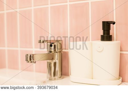 Chrome Water Faucet With Marble Counter Tops, White Sink.luxury Faucet Mixer In Bathroom. Bathtub An