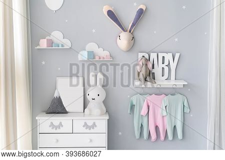 Light Nursery Room For Newborn Baby With Commode, Bunny Toys, House Decor And Clothes Wear On Rack U
