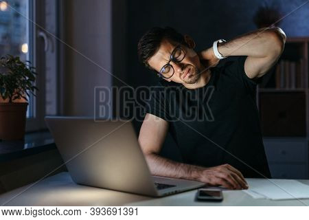 Tired Stressed Young Businessman Suffering From Neckpain Working From Home Office Sitting At Table W