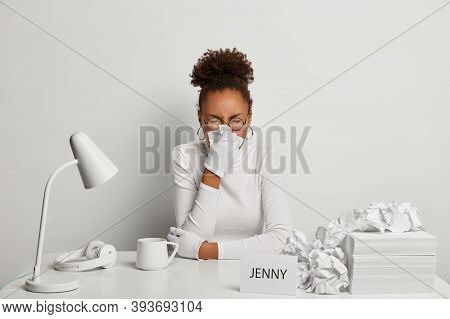 Photo Of Ill Office Worker Has Sneezing And Running Nose, Symptoms Of Flu, Wears White Turtleneck An