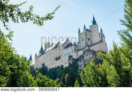 Low Angle View Of The Alcazar, A Stone Castle-palace Located In The Walled Old City Of Segovia, Spai