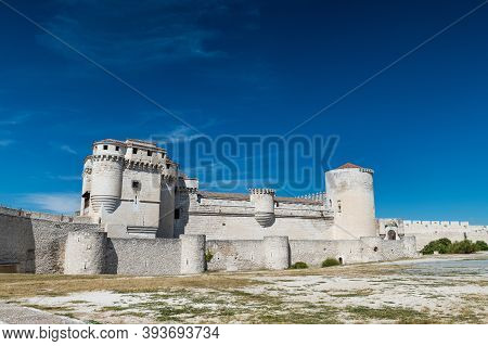 Side View Of The Well-preserved Castle Of Cuellar (castle Of The Dukes Of Alburquerque), Built In Di