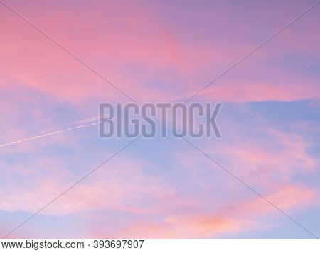 Soft, Fluffy And Colorful Cloud Formation. Abstract Idyllic Pink And Blue Sky. Blur Background Textu