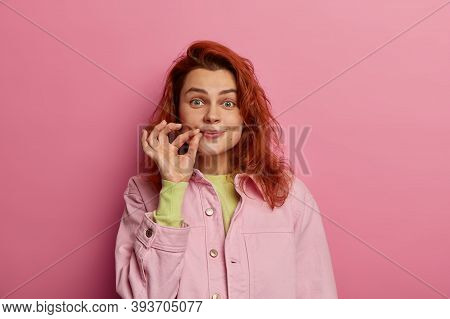 Indoor Shot Of Secret Redhead Young Woman Zips Her Mouth Shut, Promises To Keep Secret, Has Gossip S