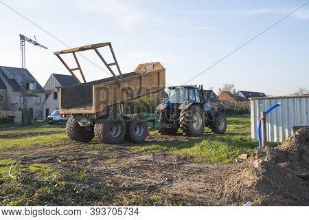 Sint Gillis Waas, Belgium, November 7, 2020, Tractor With Dump Truck On A Construction Site