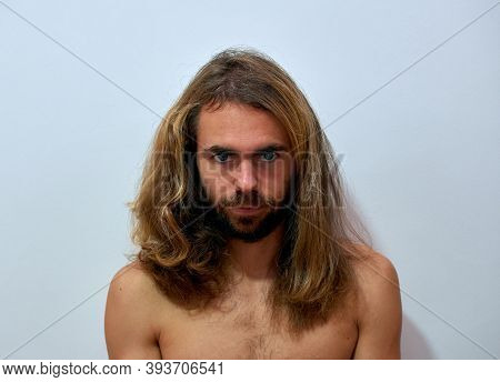 A Closeup Shot Of A Young Man With Long Beautiful Hair And A Beard