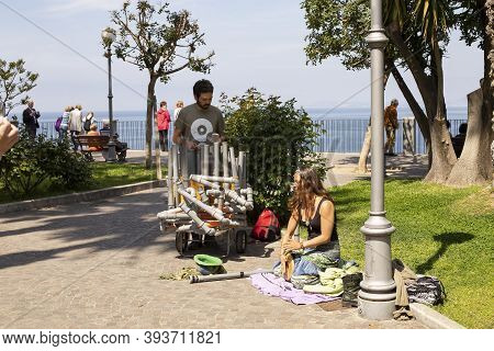 Sorrento, Gulf Of Naples, Italy - April 11, 2017: Street Musicians Play On Plastic Pipes On The Prom