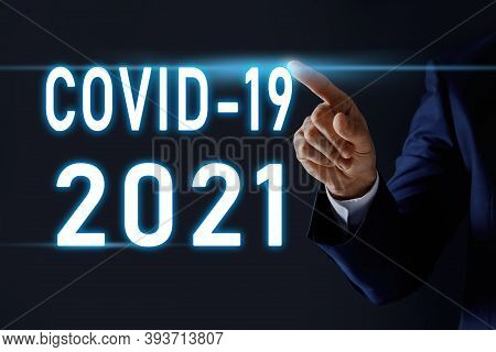 Covid-19 Predictions For 2021 Year. Man And Text On Dark Background, Closeup