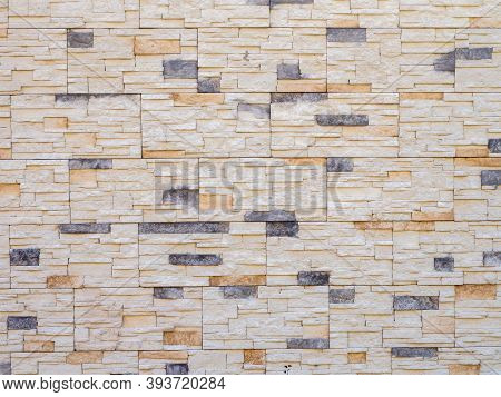 Wall With Decorative Stonework. Background Texture. Full Screen