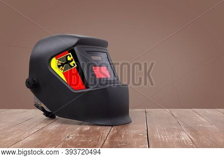 Industrial Tool - Germany Flag Mask Welding Machine On A Wooden And Brawn Wall Background