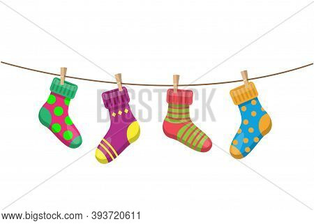 Bright Multicolored Socks With Clothespins Hang On A Clothesline