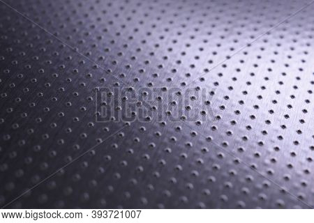Tinted Violet Or Purple Metal Tech Background. Dark Wallpaper. Perforated Aluminum Surface With Many