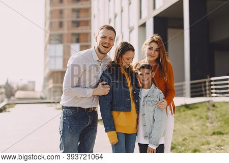 Cute Family Walks In A Spring City