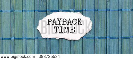 Payback Time Text On The Piece Of Paper On The Green Wood Background