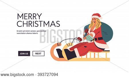 Beautiful Woman In Santa Claus Costume Riding Sledge Happy New Year Merry Christmas Holiday Celebrat