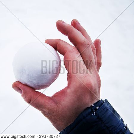 Perfect Snowball In Bare Hand. Snowball Melts In Bare Hand