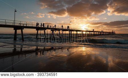 Silhouette Of Glenelg Jetty At Sunset, South Australia, Adelaide.
