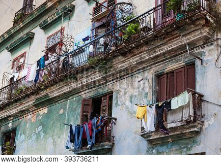 drying clothes on the balconies of the old building