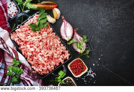 Mince, Ground Minced Meat With Ingredients For Cooking On Black Background. Top View, Copy Space