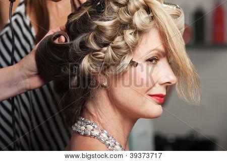 Calm mature Caucasian woman in beauty salon poster