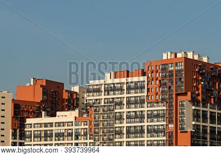 Apartment Building With Colorful Facades. Modern Minimalistic Architecture With Lots Of Square Glass