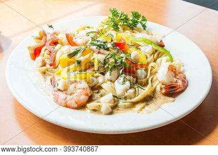 Delicious Seafood Fettuccine Pasta White Sauce - Close Up